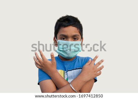 Boy wearing protective mask and show stop hands gesture for stop corona virus outbreak  #1697412850