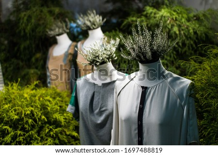 White mannequins , with heather on a dark green forest background. The concept of fashion, style, beauty, ecology, recycle, sustainability, reusing, concept. Zero and fabric waste, creative background Royalty-Free Stock Photo #1697488819