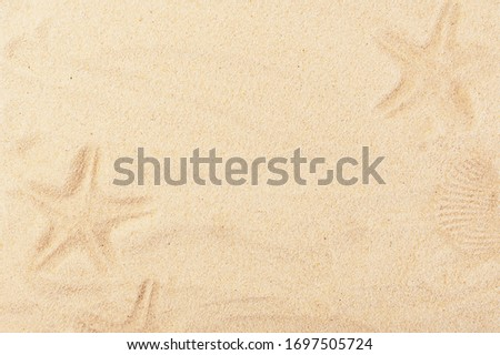 Warm summer backdrop with painted sand pictures. Baby drawn starfish background. Empty space for creative design or text. Holidays and travelling concept