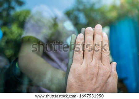 Social distancing among the family, the hand of the mother and daughter on a window plane, concept coronavirus, covid-19 pandemic.Work from home (WFH), Social distancing, Quarantine,  #1697531950