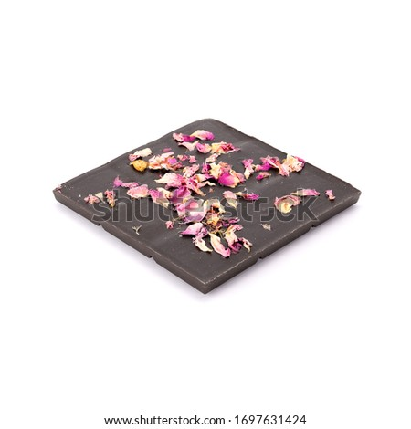Handmade organic dark chocolate with rose oil from Damascena rose and sprinkled with rose leaves. Isolated on white background. #1697631424