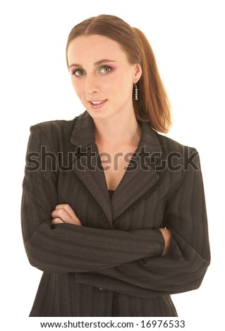 Sexy young adult Caucasian businesswoman in a black sexy business suit on a white background. She has modern make-up on her eyes #16976533
