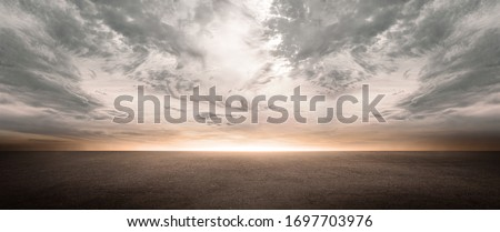 Dark Concrete Floor Background with Scenic Night Sky Horizon and Dramatic Clouds #1697703976