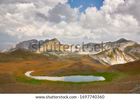 Mountain pond with crystal clear water high in the mountains. Mounta Korab and national park of Mavrovo, Macedonia #1697740360