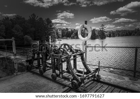 Monochrome picture of railway gear mechanism for hauling logs