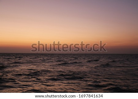 A picture of the twilight period during the sunset at the sea/ocean/lake can be used  for background
