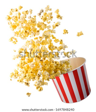 Flying popcorn from paper striped bucket isolated on black background with clipping path. Concept of cinema or watching TV. #1697848240