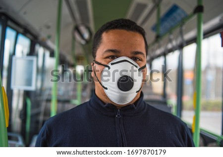 passenger wears mask in bus to protect himself from the coronavirus epidemic is alone in bus. Pandemic coronavirus 2020. Quarantine.Virus concept. Epidemic infection. #1697870179