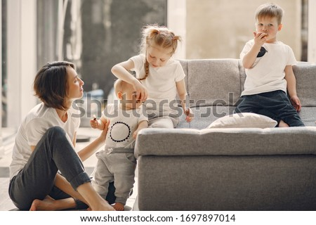 Coronavirus theme. Mother with childre. Family stay at home. #1697897014