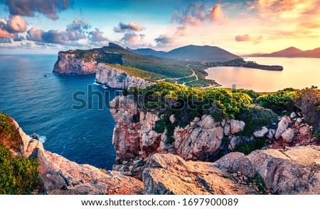 Exciting morning view of Caccia cape. Nice spring sunrise on Sardinia island, Italy, Europe. Great morning seascape of Mediterranean sea. Beauty of nature concept background. Royalty-Free Stock Photo #1697900089