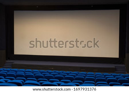 General plan of empty blue cinema seats. Deserted movie theater. Watching the movie. New movie. #1697931376