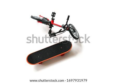 Finger board / skateboard and finger bike / bmx toys on white background isolated in focus. Little wheels for play. #1697931979
