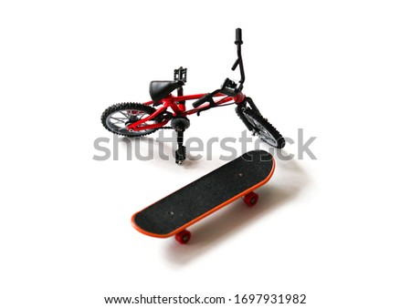Finger board / skateboard and finger bike / bmx toys on white background isolated in focus. Little wheels for play. #1697931982
