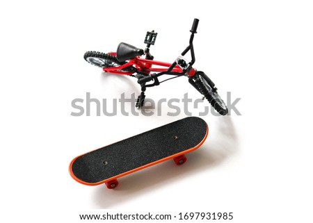 Finger board / skateboard and finger bike / bmx toys on white background isolated in focus. Little wheels for play. #1697931985