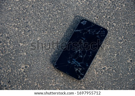 Mobile smartphone with a broken screen on the ground. Repair Gadgets Background