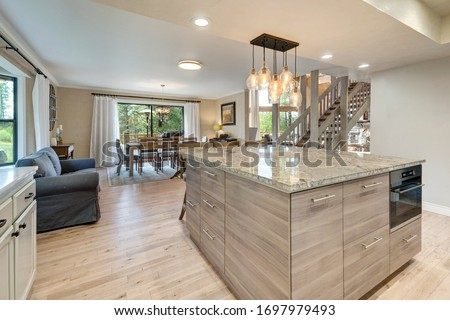 Linen, beige, light oak, Luxury home dining room and kitchen interior with natural rustic modern deisgn. #1697979493