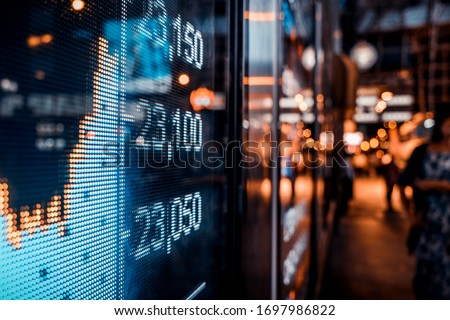 Financial stock exchange market display screen board on the street, selective focus #1697986822