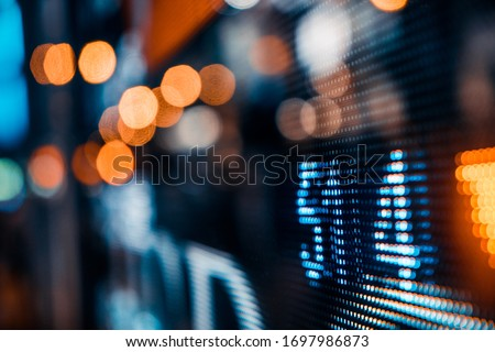 Financial stock exchange market display screen board on the street, selective focus #1697986873