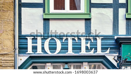 Signboard Hotel on an old house.