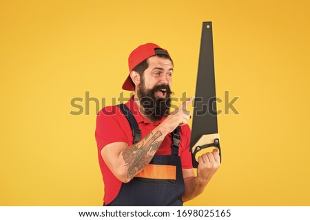 Man hold handsaw in hand. Carpentry works. Repair wooden objects. Carpentry service. Carpentry workshop concept. Professional tools. Builder worker carpenter handyman hold saw. Safety measures. #1698025165