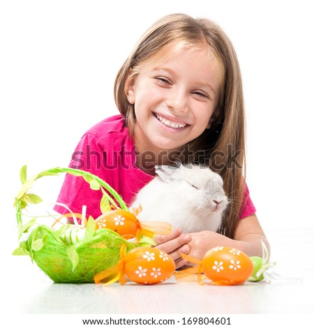 Easter photo. little cute girl and rabbit