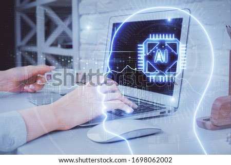 Multi exposure of woman hands working on computer and brain hologram drawing. Ai concept. #1698062002