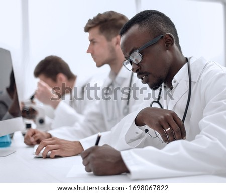 group of doctors sitting in the laboratory #1698067822