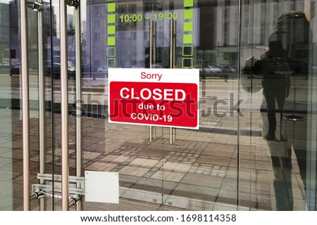 Business center closed due to COVID-19, sign with sorry in door. Stores, offices, other commercial buildings temporarily closed during coronavirus pandemic. Economy crisis and lockdown concept. Royalty-Free Stock Photo #1698114358