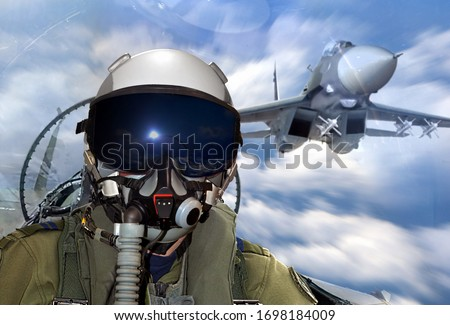 jet fighter pilot maneuver during training  exercise in mid air Royalty-Free Stock Photo #1698184009