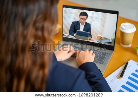 Women working at home meeting via video conferencing for social distance. #1698201289