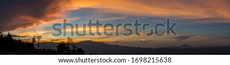 Panorama picture of sunset northern mountain of Thailand blue orange sky twilight clouds