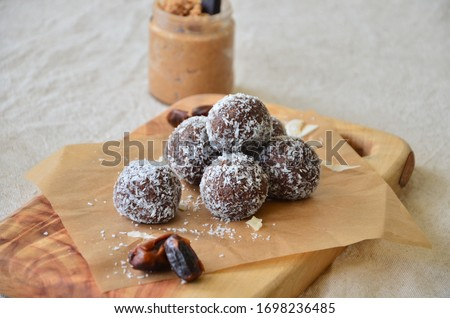 Healthy treats balls, made from peanut butter, almond butter and nuts Royalty-Free Stock Photo #1698236485