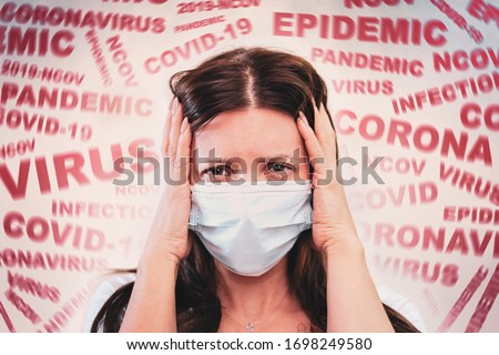 a woman with a mask on his face, scared by the news of the coronavirus covid-2019. Panic situation. Fear of getting sick. concept of the spread of coronavirus. The patient is scared covid 19. #1698249580