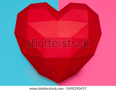 polygonal big heart. heart made of cardboard. polygonal big heart on a double colored blue-pink background.Valentine's Day.