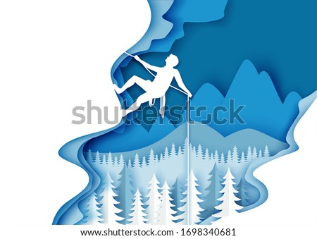 Vector layered paper cut style winter mountains landscape with alpinist male character climbing ice rock with rope. Extreme winter sports. Mountain hiking, mountaineering, ice climbing, adventure.