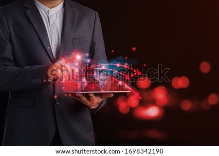 Economic collapse concept, businessman and Crisis chart with downwards arrow, great for topics like financial problems, recession, debt, inflation, market collapse etc. Royalty-Free Stock Photo #1698342190