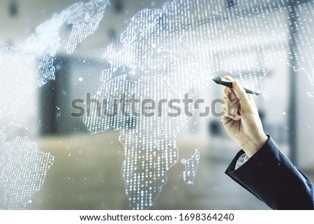 Multi exposure of man hand with pen working with abstract creative digital world map hologram on blurred office background, tourism and traveling concept #1698364240