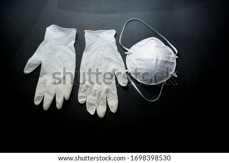 Remedies for coronavirus Covid-19.This is a mask on the face and gloves on the hands. #1698398530