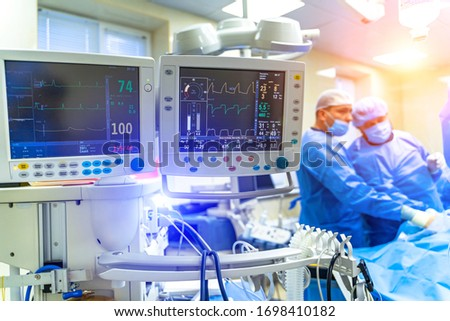 Artificial lung ventilation monitor in the intensive care unit. Nurse with medical equipment. Ventilation of the lungs with oxygen. COVID-19 and coronavirus identification. Pandemic. #1698410182