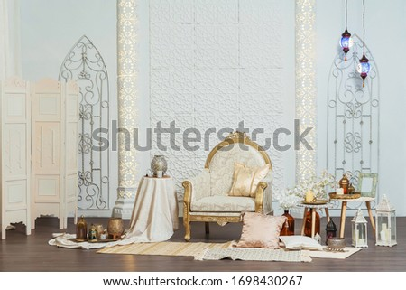 White and gold interior chair and tables in Oriental style. Moroccan middle East Decoration in Eastern Arabic style design. White room in Oriental style #1698430267