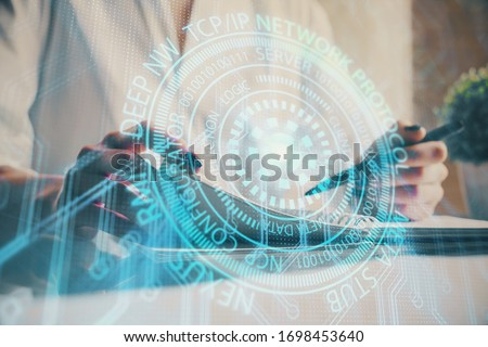 Multi exposure of hands making notes with digital coding icons. Computer learning concept. #1698453640