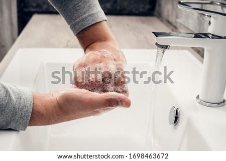 Coronavirus. Proper washing and handling of hands. Liquid antibacterial soap. Self-isolation and hygiene #1698463672
