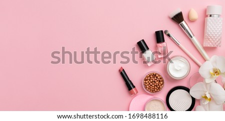 Beauty background with facial cosmetic products with empty copy space. Makeup, skin care concept with pastel colored background. Royalty-Free Stock Photo #1698488116