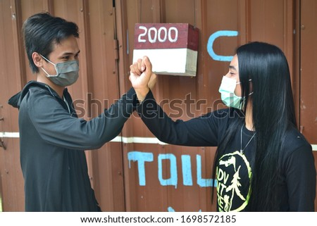 Pasuruan, Indonesia, April 9, 2020: efforts to break the chain of spreading of coronavirus by staying at home and always wearing a mask and keeping a distance to touch. #1698572185