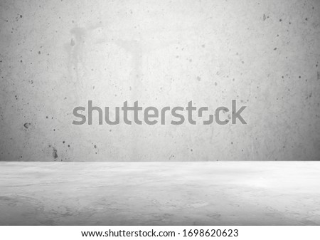 Room empty with cement floor and concrete wall
