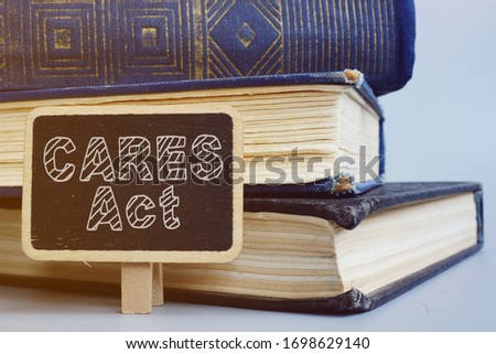 Text sign showing hand written words The Coronavirus Aid, Relief, and Economic Security (CARES) Act Royalty-Free Stock Photo #1698629140