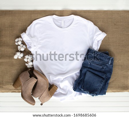 White shirt mockup - tshirt with cotton plant, burlap, boots and jeans Royalty-Free Stock Photo #1698685606