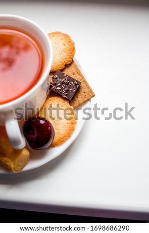 cup of tea with cookies #1698686290