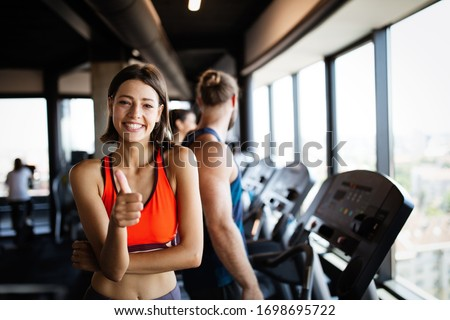 Beautiful fit young woman training in gym #1698695722