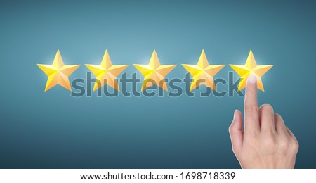 Hand of touching rise on increasing five stars. Increase rating evaluation and classification concept #1698718339